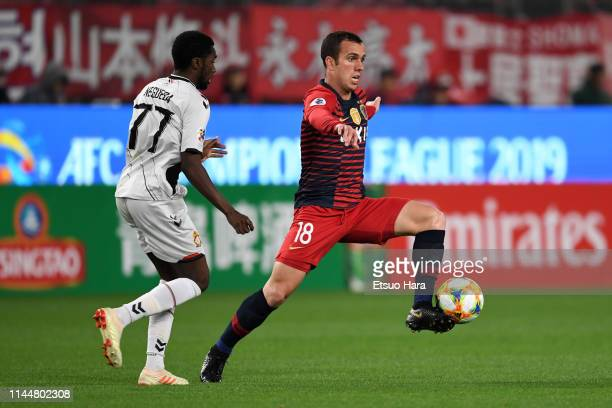 Serginho of Kashima Antlers and Negueba of Gyeongnam compete for the ball during the AFC Champions League Group E match between Kashima Antlers and...