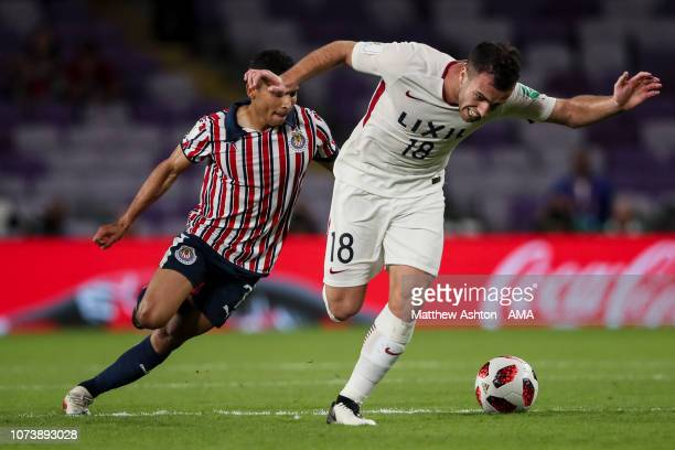 Serginho of Kashima Antlers and Orbelin Pineda of CD Guadalajara during the FIFA Club World Cup UAE 2018 match between Kashima Antlers and CD...