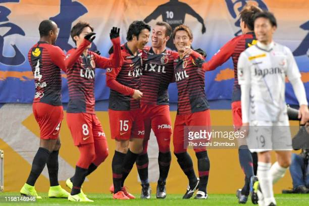 Serginho of Kashima Antlers celebrates scoring the opening goal with his team mates during the 99th Emperor's Cup semi final match between Kashima...