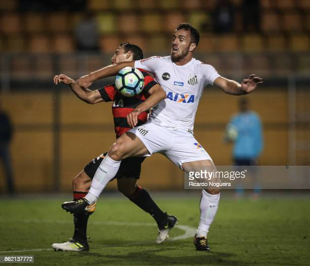 Serginho of Santos battles for the ball with Soutto 57 of Vitoria during the match between Santos and Vitoria as a part of Campeonato Brasileiro 2017...