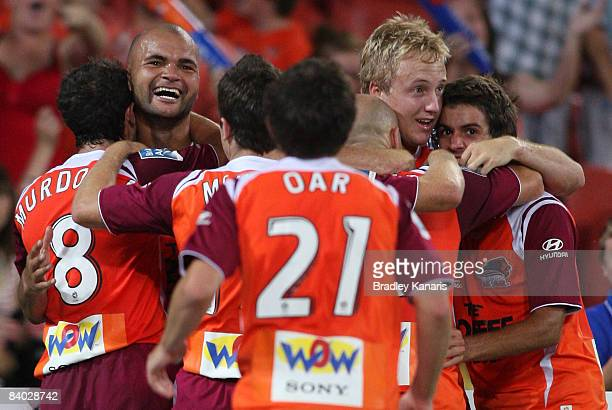 Serginho Van Dijk of the Roar celebrates with team mates after scoring a goal during the round 15 ALeague match between Queensland Roar and the...