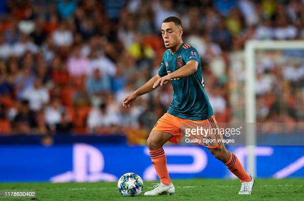 Sergino Dest of AFC Ajax runs with the ball during the UEFA Champions League group H match between Valencia CF and AFC Ajax at Estadio Mestalla on...