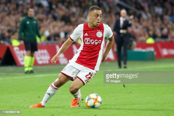 Sergino Dest of Ajax Amsterdam controls the ball during the UEFA Champions League Third Qualifying Round match between Ajax and PAOK Saloniki at...