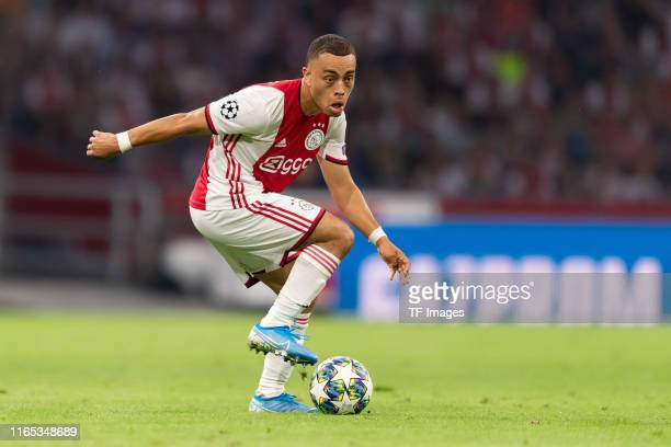 Sergino Dest of Ajax Amsterdam controls the ball during the UEFA Champions League Play Off match between Apoel Nicosia and Ajax at Johan Cruyff Arena...