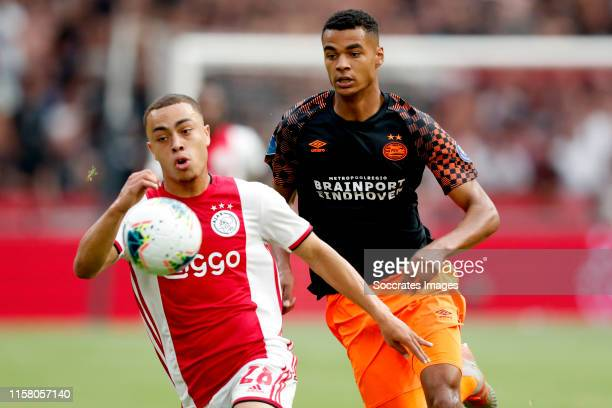 Sergino Dest of Ajax Cody Gakpo of PSV during the Dutch Johan Cruijff Schaal match between Ajax v PSV at the Johan Cruijff Arena on July 27 2019 in...