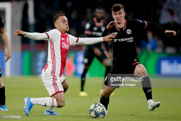 Sergino Dest of Ajax Mason Mount of Chelsea FC during the UEFA Champions League match between Ajax v Chelsea at the Johan Cruijff Arena on October 23...