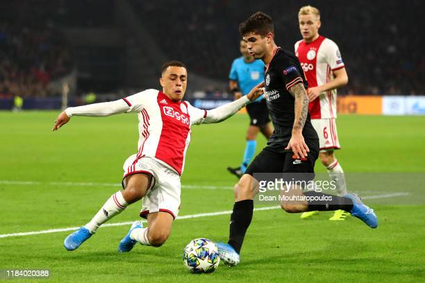 Sergino Dest of Ajax tackles Christian Pulisic of Chelsea during the UEFA Champions League group H match between AFC Ajax and Chelsea FC at Amsterdam...