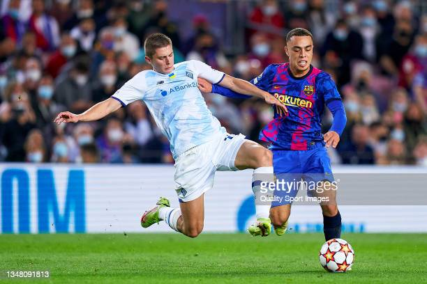 Sergino Dest of FC Barcelona competes for the ball with Vitaliy Mykolenko of Dinamo Kiev during the UEFA Champions League group E match between FC...
