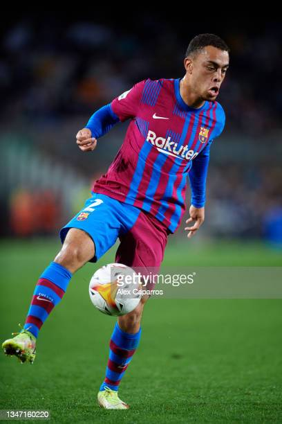 Sergino Dest of FC Barcelona controls the ball during the LaLiga Santander match between FC Barcelona and Valencia CF at Camp Nou on October 17, 2021...