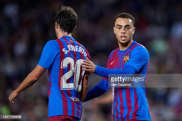 Sergino Dest of FC Barcelona interacts with his teammate Sergi Roberto during the LaLiga Santander match between FC Barcelona and Valencia CF at Camp...