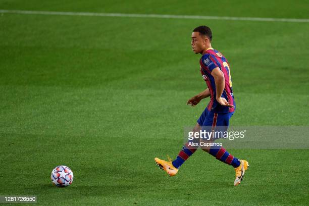 Sergino Dest of FC Barcelona plays the ball during the UEFA Champions League Group G stage match between FC Barcelona and Ferencvaros Budapest at...