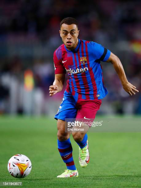 Sergino Dest of FC Barcelona runs with the ball during the La Liga Santander match between FC Barcelona and Granada CF at Camp Nou on September 20,...