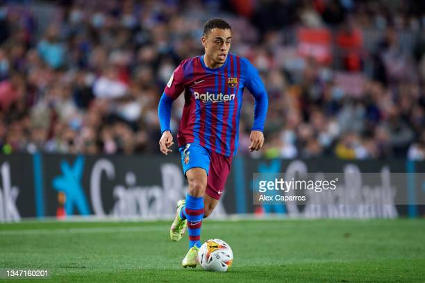Sergino Dest of FC Barcelona runs with the ball during the LaLiga Santander match between FC Barcelona and Valencia CF at Camp Nou on October 17,...