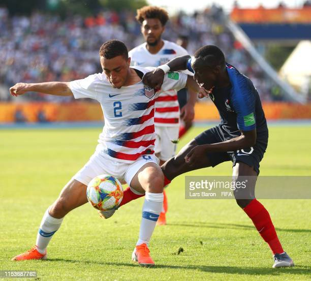 Sergino Dest of the United States and Moussa Diaby of France battle for the ball during the 2019 FIFA U20 World Cup Round of 16 match between France...