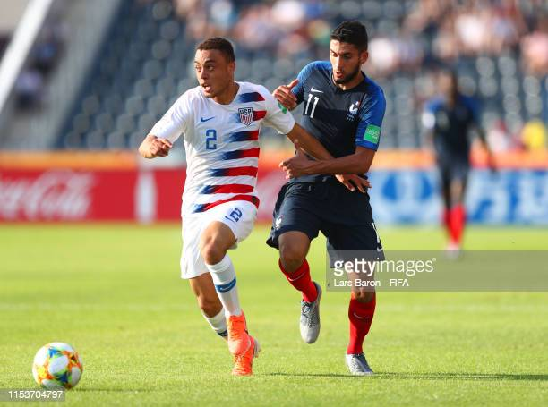 Sergino Dest of the United States battles for possession with Nabil Alioui of France during the 2019 FIFA U20 World Cup Round of 16 match between...
