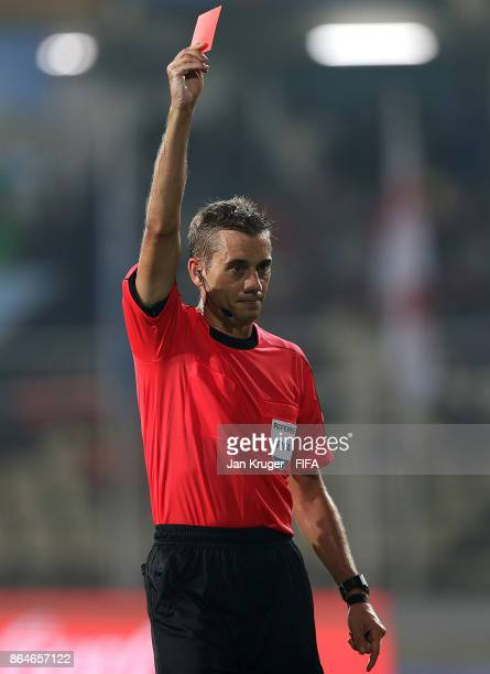 Sergino Dest of United States of America is shown a red card by referee Clement Turpin of France during the FIFA U17 World Cup India 2017 Quarter...