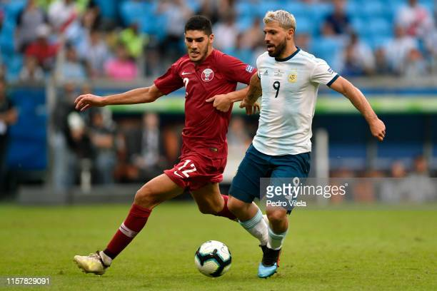 Sergio Agüero of Argentina fights for the ball with Karim Boudiaf of Qatar during the Copa America Brazil 2019 group B match between Qatar and...