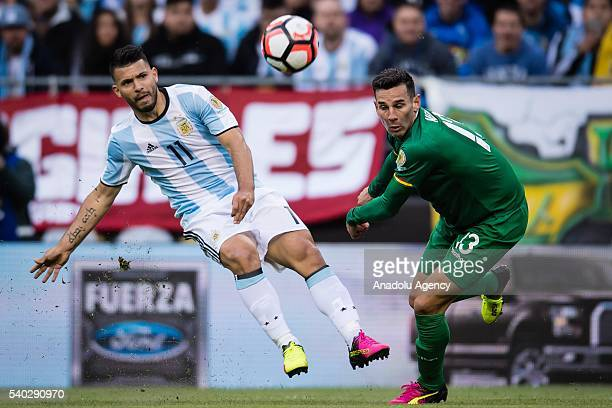 Sergio Agüero of Argentina struggles for the ball against Alejandro Melean of Bolivia during the 2016 Copa America Centenario Group D match between...