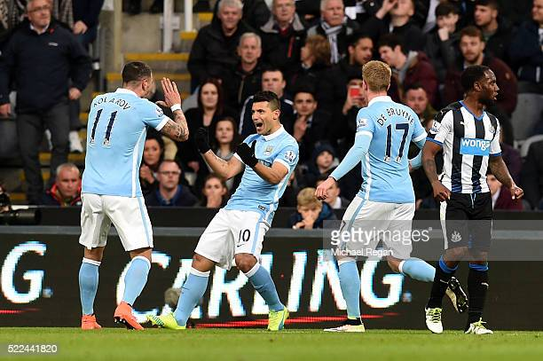 Sergio Aguero of Manchester City is congratulated by teammates after scoring the opening goal with a header during the Barclays Premier League match...
