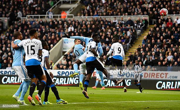 Sergio Aguero of Manchester City scores the opening goal with a header during the Barclays Premier League match between Newcastle United and...