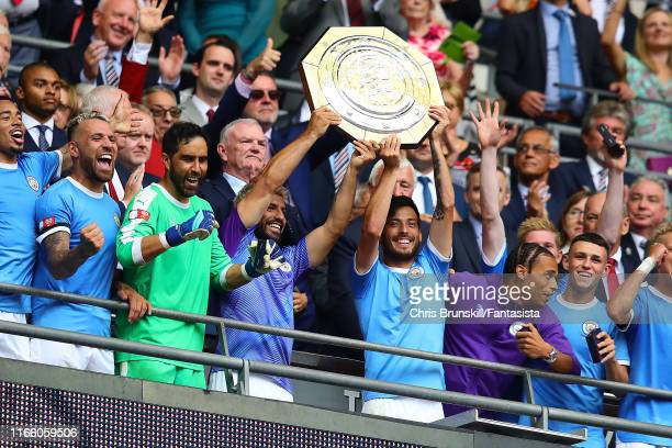 Sergio Aguero and David Silva of Manchester City lift the trophy following the FA Community Shield match between Liverpool and Manchester City at...