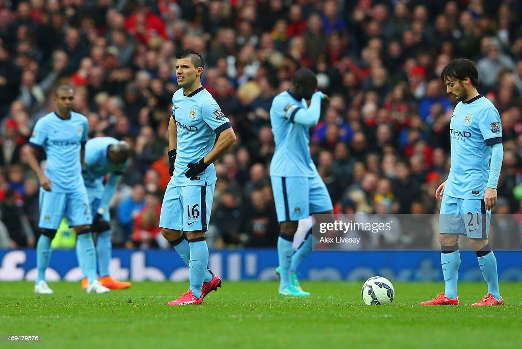 Sergio Aguero (16) and David Silva of Manchester City