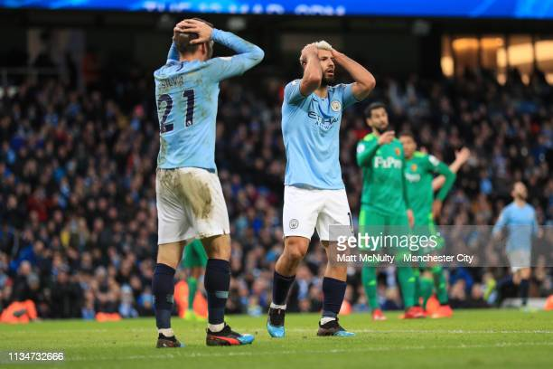 Sergio Aguero and David Silva of Manchester City react during the Premier League match between Manchester City and Watford FC at Etihad Stadium on...