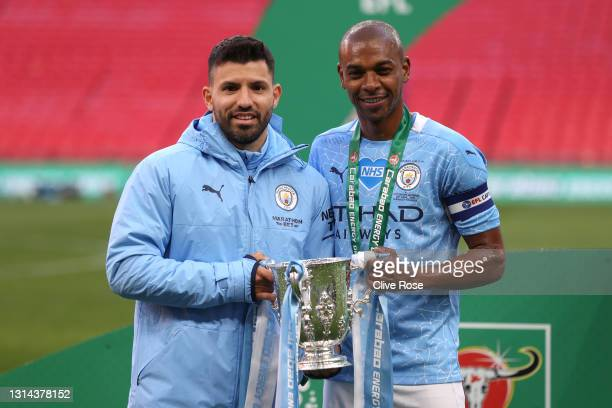 Sergio Aguero and Fernandinho of Manchester City celebrates with the trophy after winning the Carabao Cup after the Carabao Cup Final between...