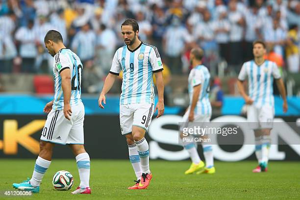 Sergio Aguero and Gonzalo Higuain of Argentina looks on after allowing a goal during the 2014 FIFA World Cup Brazil Group F match between Nigeria and...
