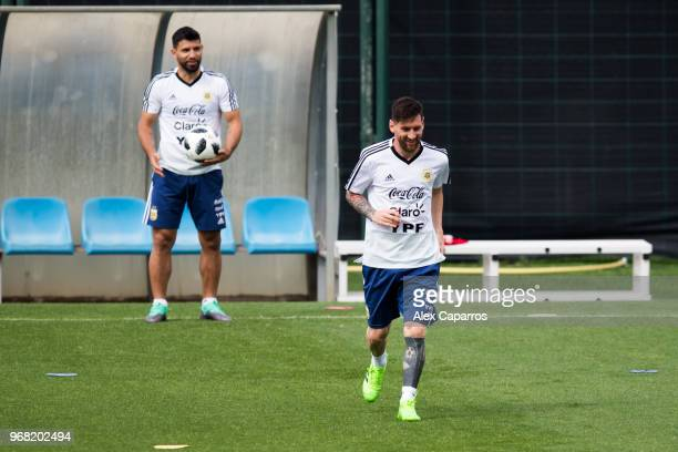 Sergio Aguero and Lionel Messi of Argentina take part in a training session as part of the team preparation for FIFA World Cup Russia 2018 at FC...