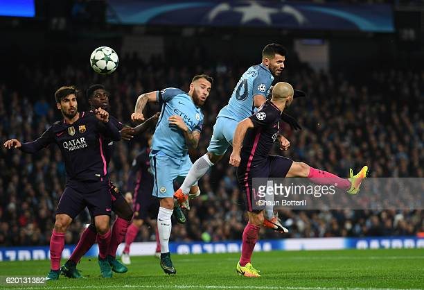 Sergio Aguero and Nicolas Otamendi of Manchester City attack the Barcelona goal during the UEFA Champions League Group C match between Manchester...