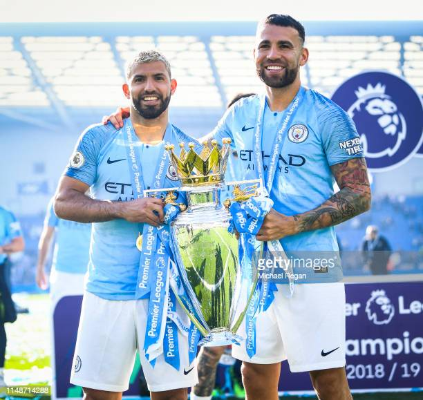 Sergio Aguero and Nicolas Otamendi of Manchester City celebrate with the Premier League trophy during the Premier League match between Brighton Hove...