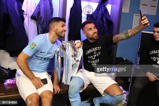 Sergio Aguero and Nicolas Otamendi of Manchester City celebrate with the trophy after winning the Carabao Cup Final between Arsenal and Manchester...