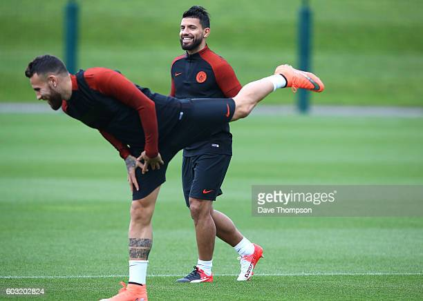 Sergio Aguero and Nicolas Otamendi of Manchester City during a training session ahead of the UEFA Champions League match between Manchester City and...