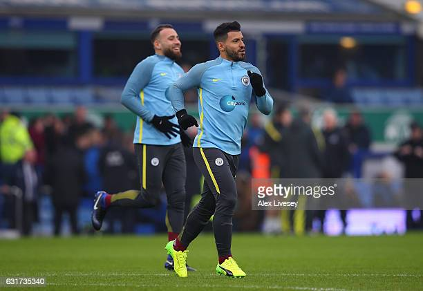 Sergio Aguero and Nicolas Otamendi of Manchester City warm up prior to kickoff during the Premier League match between Everton and Manchester City at...