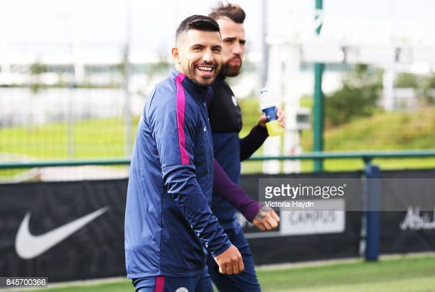 Sergio Aguero and Nicolas Otamendi walk out to training at Manchester City Football Academy on September 11 2017 in Manchester England