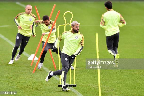 Sergio Aguero, Bernardo Silva and Angelino participate in a training session ahead of the UEFA Champions League Group C match against Atalanta at The...