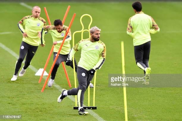 Sergio Aguero Bernardo Silva and Angelino participate in a training session ahead of the UEFA Champions League Group C match against Atalanta at The...