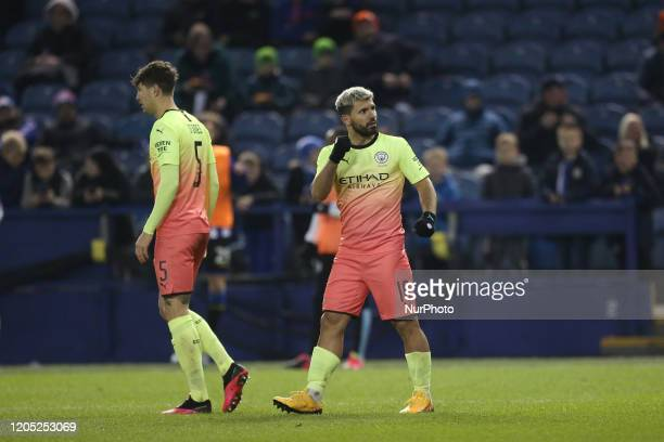 Sergio Aguero celebrates with his team mates after scoring their first goal during the FA Cup Fifth Road match between Sheffield Wednesday and...