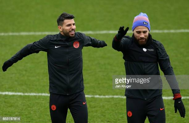 Sergio Aguero chats with Nicolas Otamendi during a Manchester City training session prior to the UEFA Champions League Round of 16 Second Leg match...