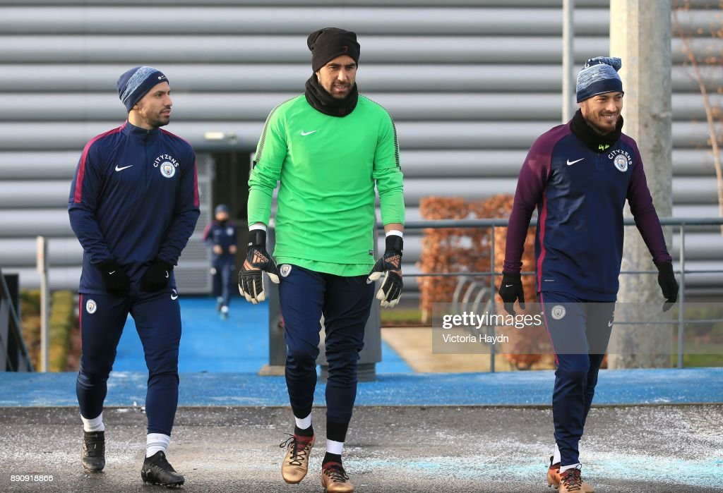 Sergio Aguero, Claudio Bravo and David Silva walk to training at Manchester City Football Academy on December 12, 2017 in Manchester, England.