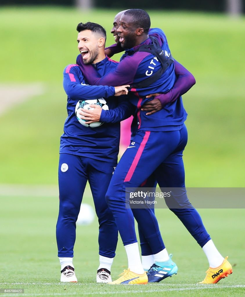 Sergio Aguero, Eliaquim Mangala and Yaya Toure group together during training at Manchester City Football Academy on September 11, 2017 in Manchester, England.