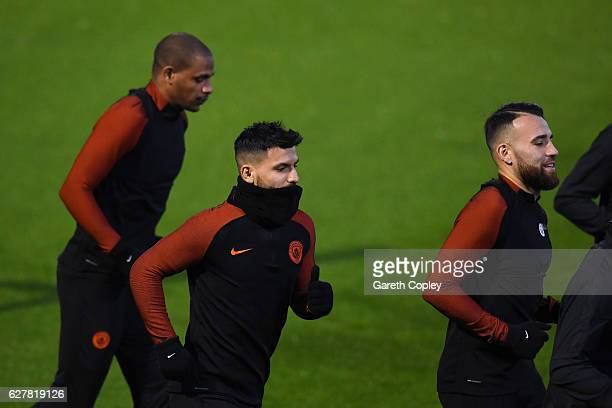 Sergio Aguero Fernando and Nicolas Otamendi of Manchester City run during a training session ahead of the UEFA Champions League group C match against...