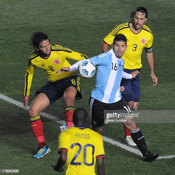 Sergio Aguero from Argentina protects the ball during a match between Argentina and Colombia as part of the group A of the Copa America 2011 at...