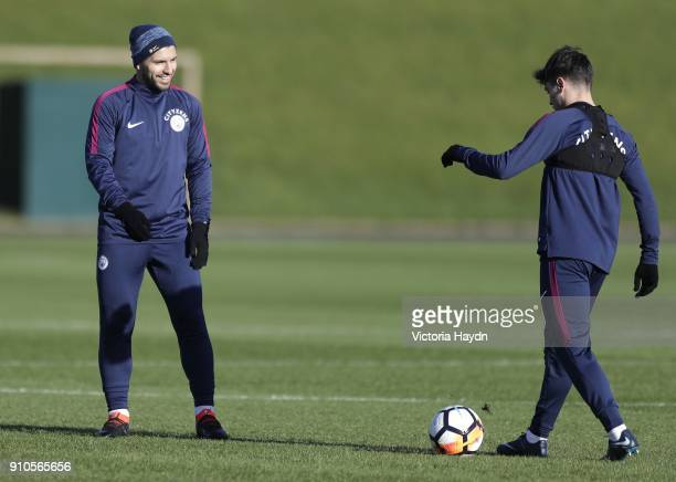 Sergio Aguero jokes with Brahim Diaz during training at Manchester City Football Academy on January 26 2018 in Manchester England