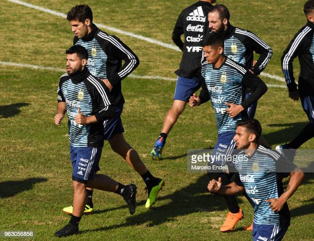Sergio Aguero Marcos Rojo and Gonzalo Higuaín run during a training session open to the public as part of the team preparation for FIFA World Cup...