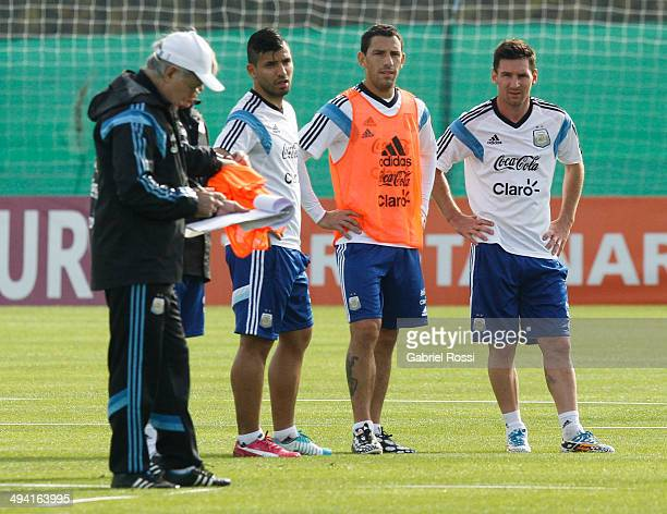 Sergio Aguero Maximiliano Rodriguez and Lionel Messi of Argentina during a training session at Ezeiza Training Camp on May 28 2014 in Ezeiza Argentina