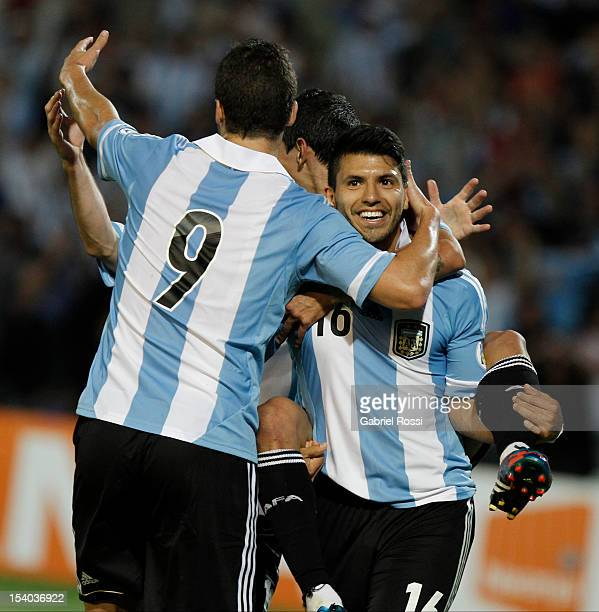 Sergio Aguero of Argentina celebrates a goal with his teammates during a match between Argentina and Uruguay as part of the South American Qualifiers...