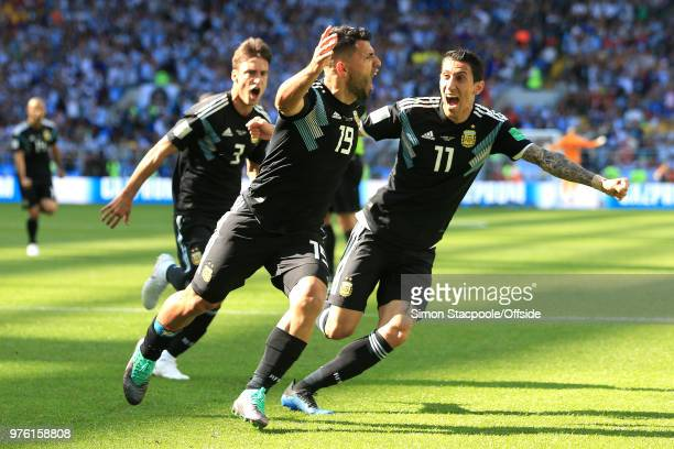 Sergio Aguero of Argentina celebrates scoring their 1st goal with Nicolas Tagliafico of Argentina and Angel Di Maria of Argentina during the 2018...