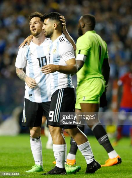 Sergio Aguero of Argentina celebrates with teammate Lionel Messi after scoring the fourth goal of his team during an international friendly match...